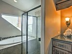 Find a soaking tub and walk-in shower in the en-suite bath.
