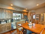 The kitchen features a center island with seating for 4.