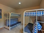 The fourth bedroom features 2 twin-over-futon bunk beds!