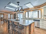 The center island offers additional counter space and bar-style seating.