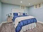The third bedroom houses a queen-sized bed.