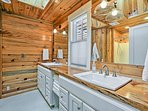 This full en-suite bathroom is highlighted by double sinks.