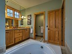 The master bathroom offers a soaking tub and walk-in shower.