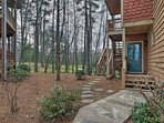 The wooded property is serene and private.