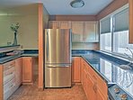 Stainless steel appliances and granite countertops enhance the space.