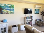 Living room, AC, fans Smart TV, books to read, music dock, pictures with scenes from Barbados