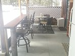 Fully covered patio with fridge and bbq