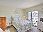 The master bedroom boasts a cozy queen bed.