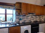 Cobble Court well equipped kitchen, dishwasher, washing machine, oven & hob, fridge with ice box
