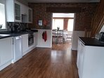 kitchen with dishwasher , fridge , freezer, washer/dryer , gas hob , electric oven, microwave