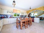 Delight in the beautiful kitchen and entertain your guests, or take pleasure in dining al fresco in