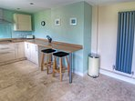 Kitchen/diner with sliding patio door to large rear enclosed patio and garden,