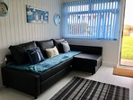 New corner sofa bed in living area with amazing views across to Bembridge Down.