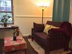 The comfy new futon and Tiffany lamp in the study with orchids everywhere