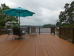 Large deck extending over the lake. Propane grill, 2 chaise lounges and dining table with 4 chairs