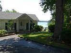 Beautiful Lake Hamilton cottage with large deck that extends over the lake. Boat-slip under deck.