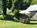 Mulberry's rear garden shaded by veteran oak trees; ideal for a spot of al fresco dining