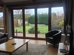 View from lounge out onto large fully enclosed garden