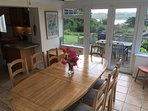 Large kitchen/dining room opens onto a spacious deck with BBQ.