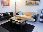 Air-conditioned lounge with comfortable seating for all guests
