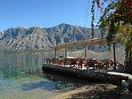 Konoba Gusti restaurant terrace in Prcanj renowned fish restaurant in all Kotor Bay. Very popular.