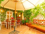 Terrace with dining area and wooden bench