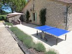 Back patio is a sun trap, with table tennis table.