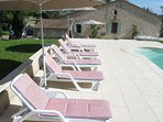 Parasols and sunbeds provided along with toys for the pool
