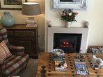 Electric effect fire - and lots of DVD's and magazines / books to read and relax with !