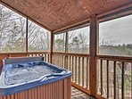 Enjoy mountain views from your private deck and hot tub.