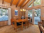 Large sliding doors lead you out to the large deck and front of home