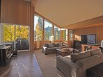 Spacious living room with a wood burning fire place looking over the mountains