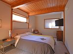Guest bedroom with a queen bed