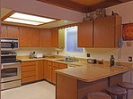The kitchen features tons of counter space