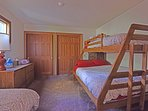 Upstairs guest bedroom with one twin and a queen/twin bunk bed