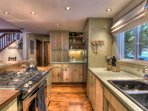 Thoughtfully designed kitchen area with updated stainless steel appliances