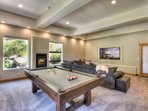 Downstairs family room with pool table and gas fireplace