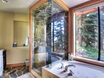 Master bedroom ensuite bathroom with beautiful forest views