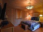 The master bedroom has a cozy rustic feel