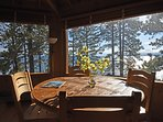 The dining table is perfectly placed to take in the lake views.