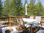 Back deck with outdoor table and chairs