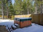 Hot tub in the spacious backyard