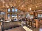 High ceilings and wraparound couch family room