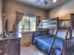 Second guest bedroom with twin topped and full bottomed style bunk bed