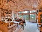 The living rooms large, open windows offer tons of natural light and lead out to the front deck