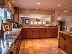 Bright kitchen with granite countertops