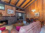 Another view of the living room with beautiful wood paneling
