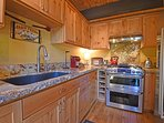Appointed with stainless steel appliances and granite counters
