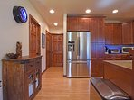Soft wood floors paired with stained wood cabinets and doors