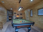 Play a game of pool with family and friends in the game room.